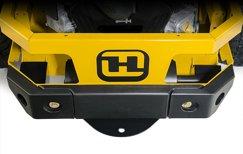 Image of the rear engine guard of a mower wrapped with a black thick plastic guard.