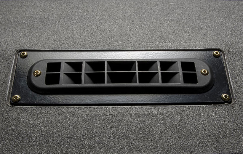 Image of a black vent on a dash of a utility vehicle.