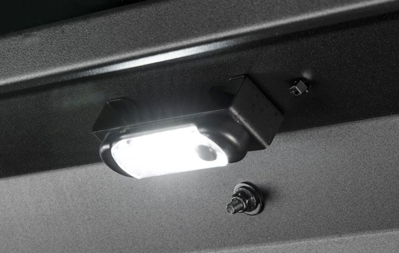 Image of a dome light mounted on a metal bar.