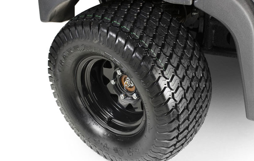 Image of the front tire of a utility vehicle on a white background.