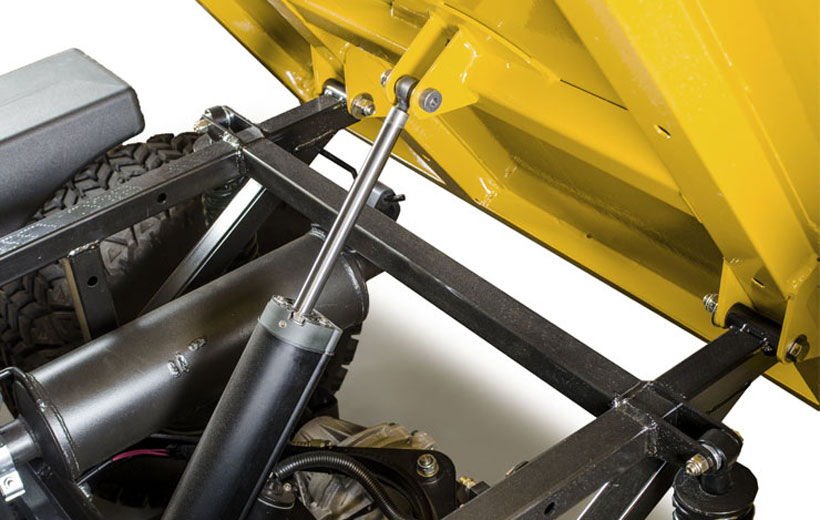 Image of the underside of a utility vehicle bed tipped up to show the dump mechanism.