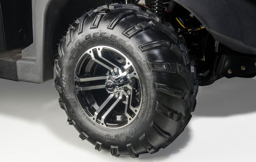 Image of a tire of a utility vehicle on a white background.