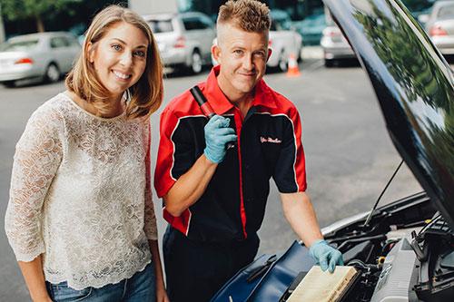 An expert mechanic helps a YourMechanic customer with a problem