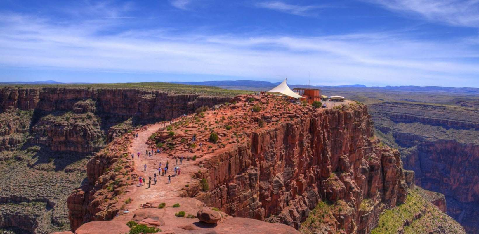 Grand Canyon West Rim Bus Tour with Helicopter, Boat and Skywalk Tickets