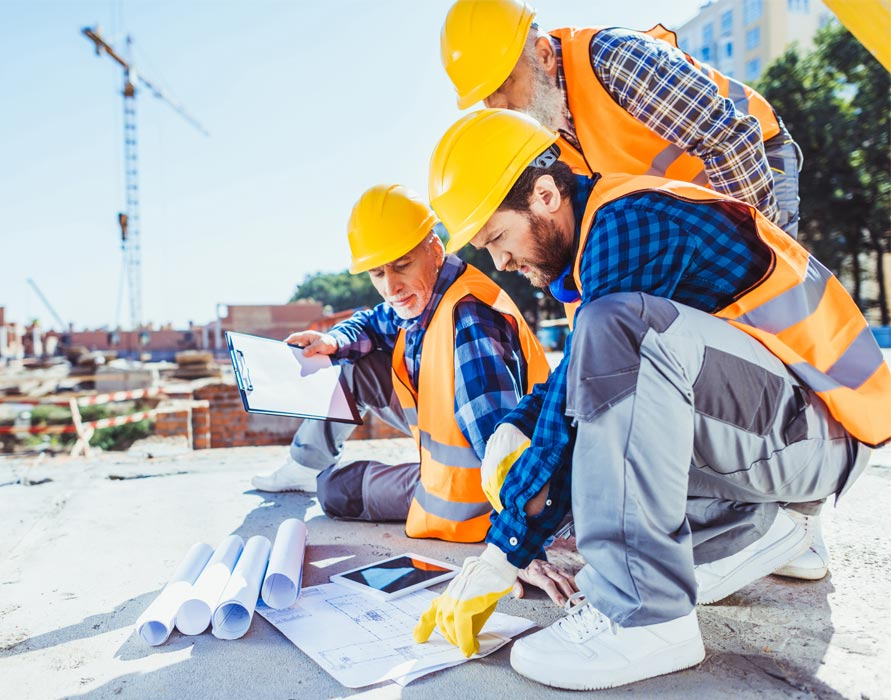 contractors reviewing construction bids and specifications