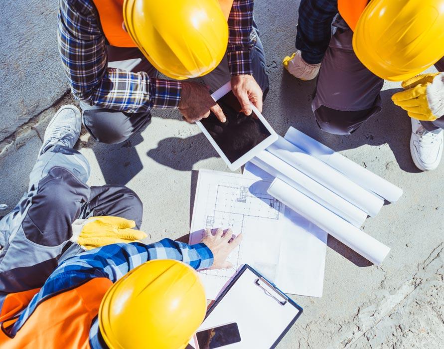 contractors reviewing blueprints