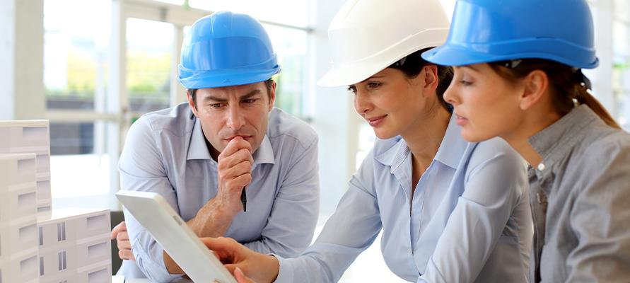 contractors looking a construction plans