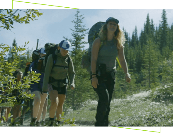 People hiking with equipment