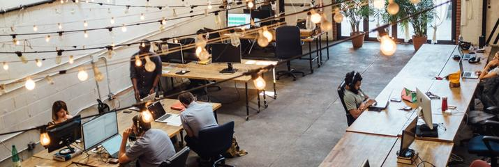 Top view of startup company with people working at desks