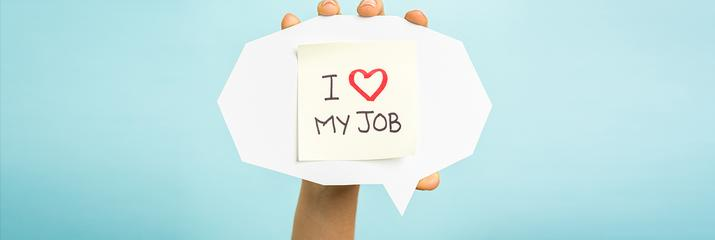 Person holding sign saying I love my job