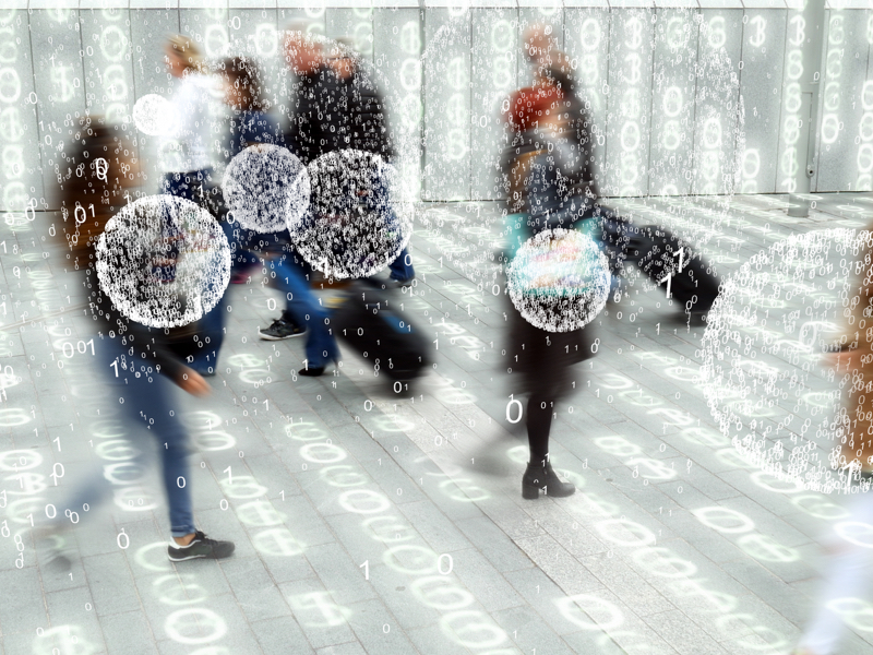 People walking with data around them