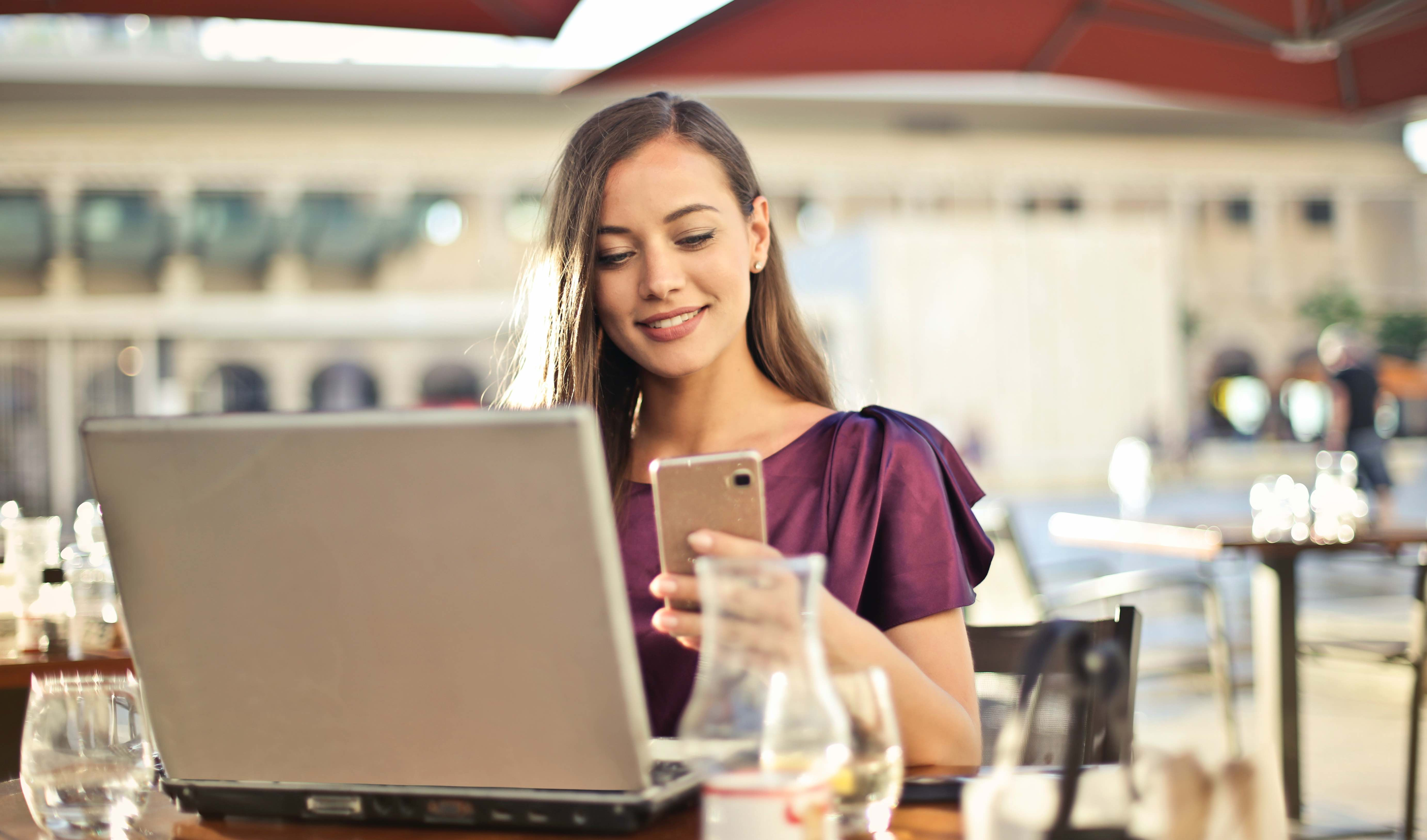 Woman working remotely at cafe