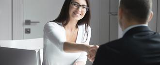 Woman shakes man's hand