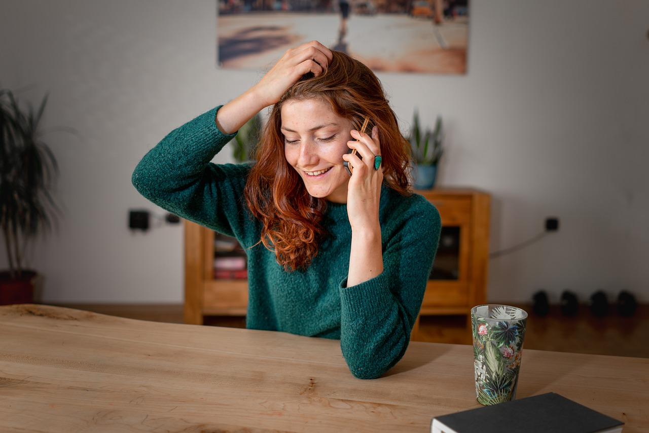 Woman at desk talking on the phone