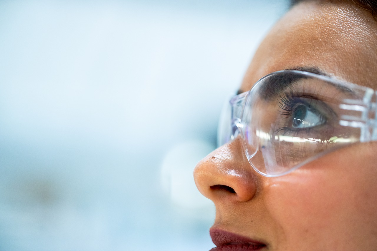 Close up photo of woman with clear plastic glasses on