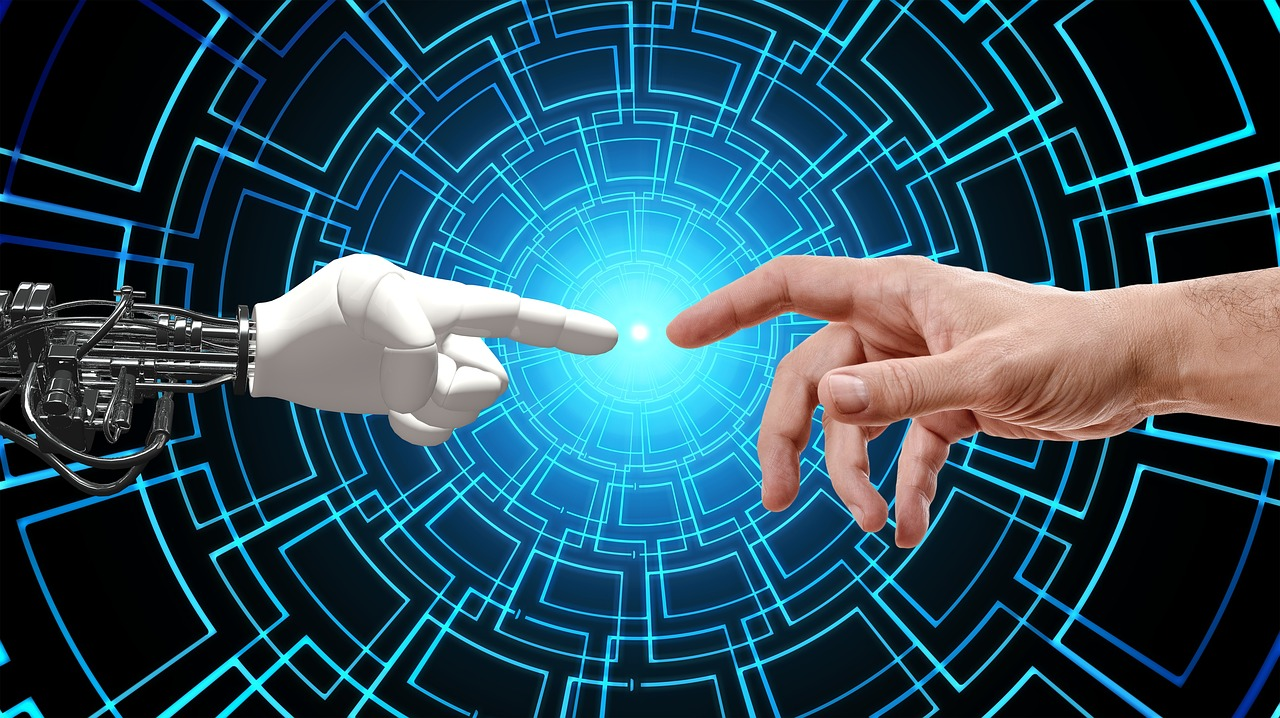 Robotic hand and human hand touching fingers