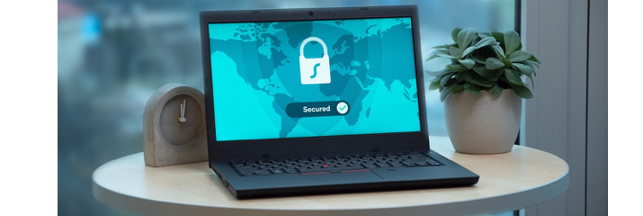 Laptop on table, online security, world map