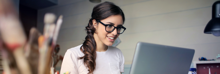 woman working at desk with laptop