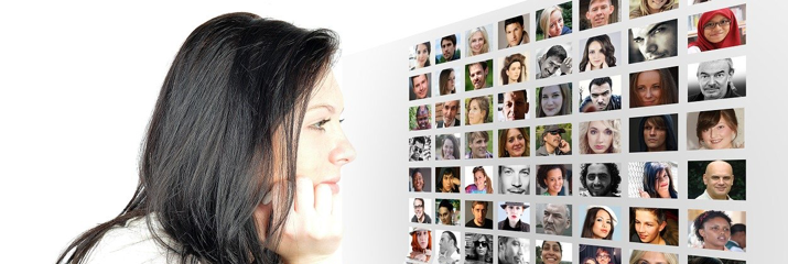 Woman looking at photos of multiple people