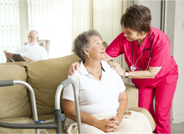 Nurse in aged care facility with elderly woman