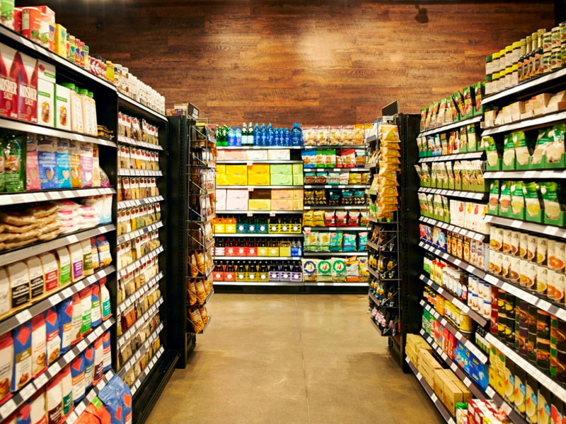 Planet organic header image, grocery store aisle