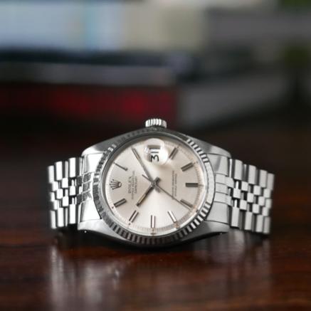 A watch on a wooden desk