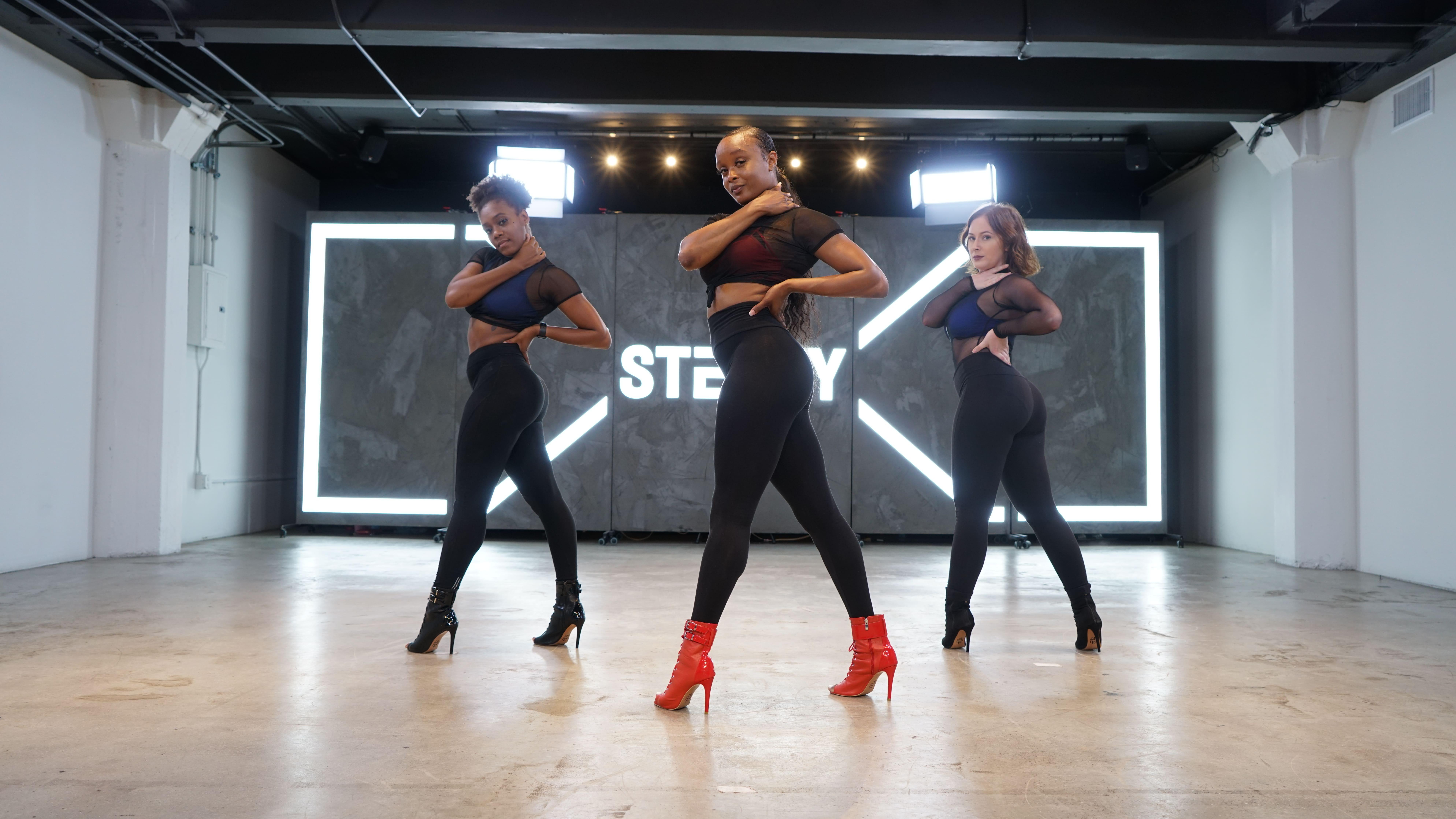 Kiira Harper and dancers posing in heels