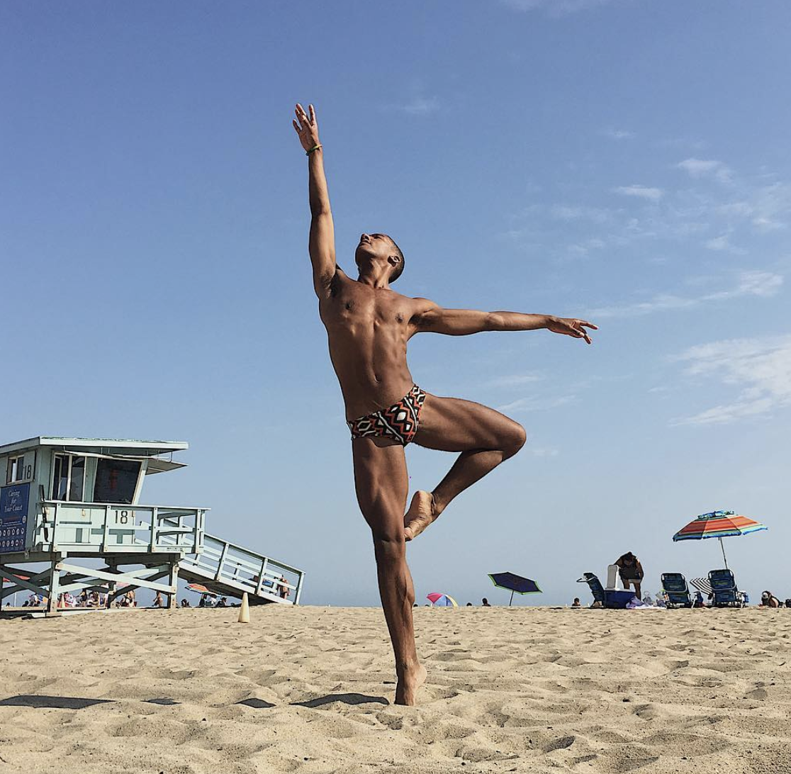 Harper Watters, a STEEZY ballet instructor, in a ballet pose on a beach