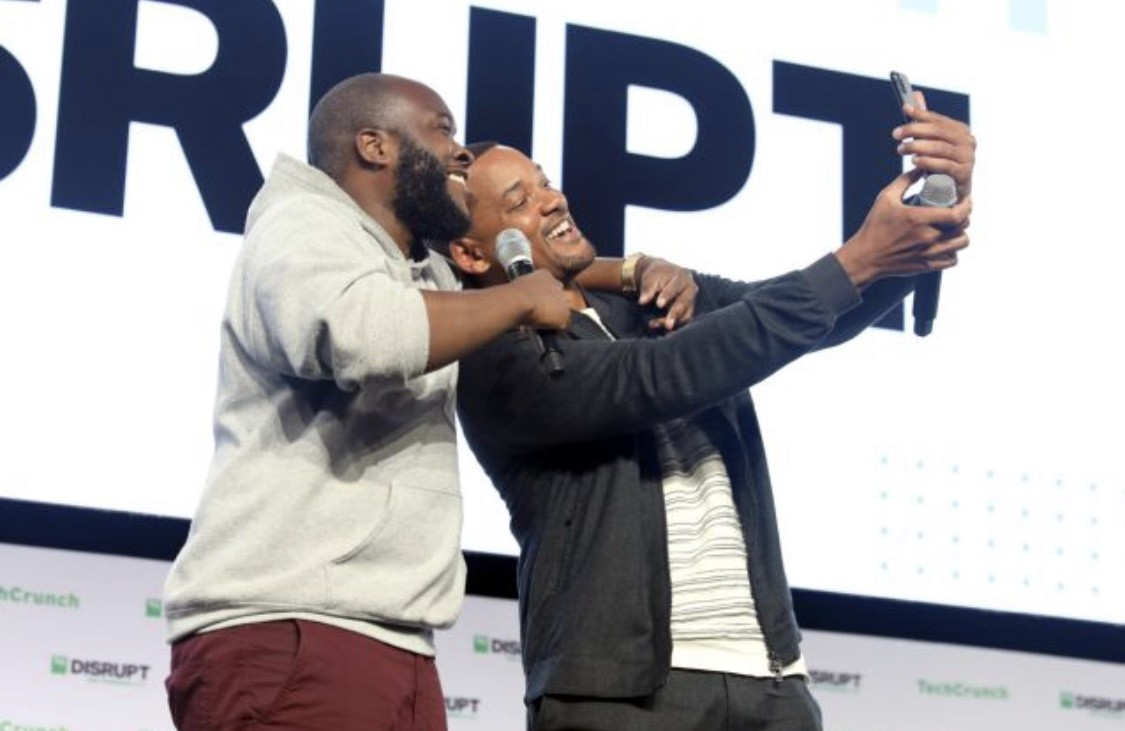 Will Smith and Kofi on stage