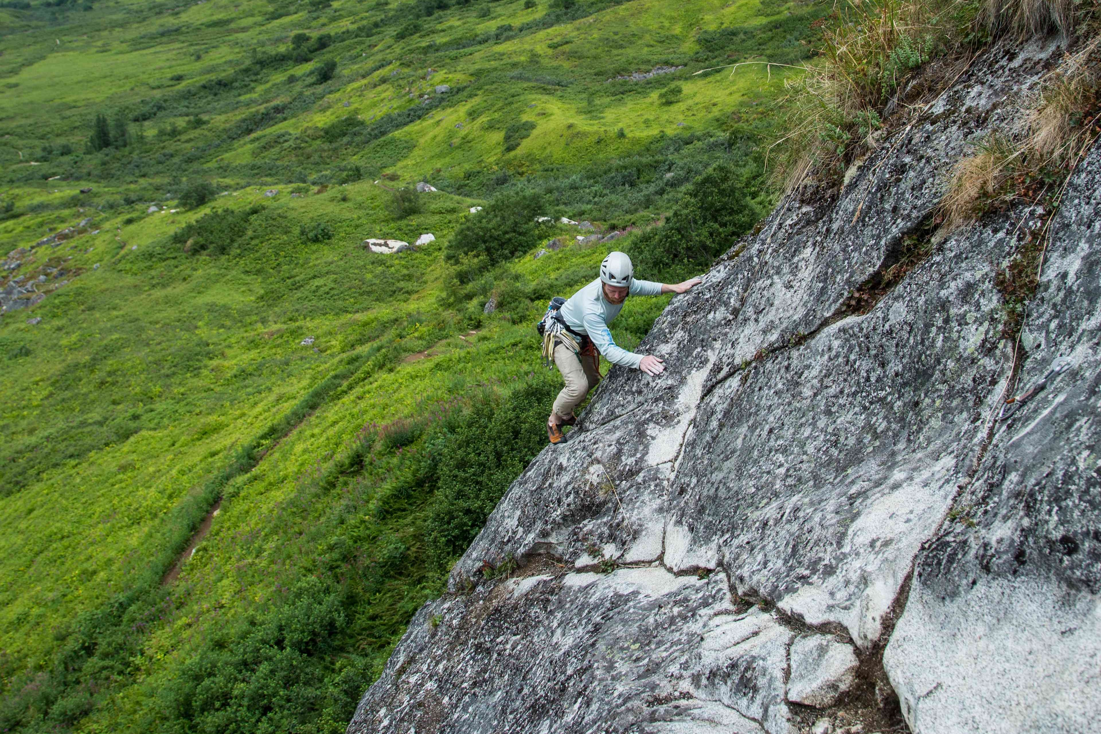 Eyeing up the next move on a slab in Hatcher Pass