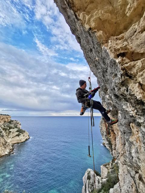 Maurizio Oviglia bolting a sport route