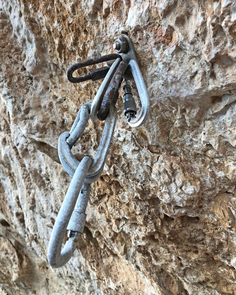 Rusted anchors on a sport climb
