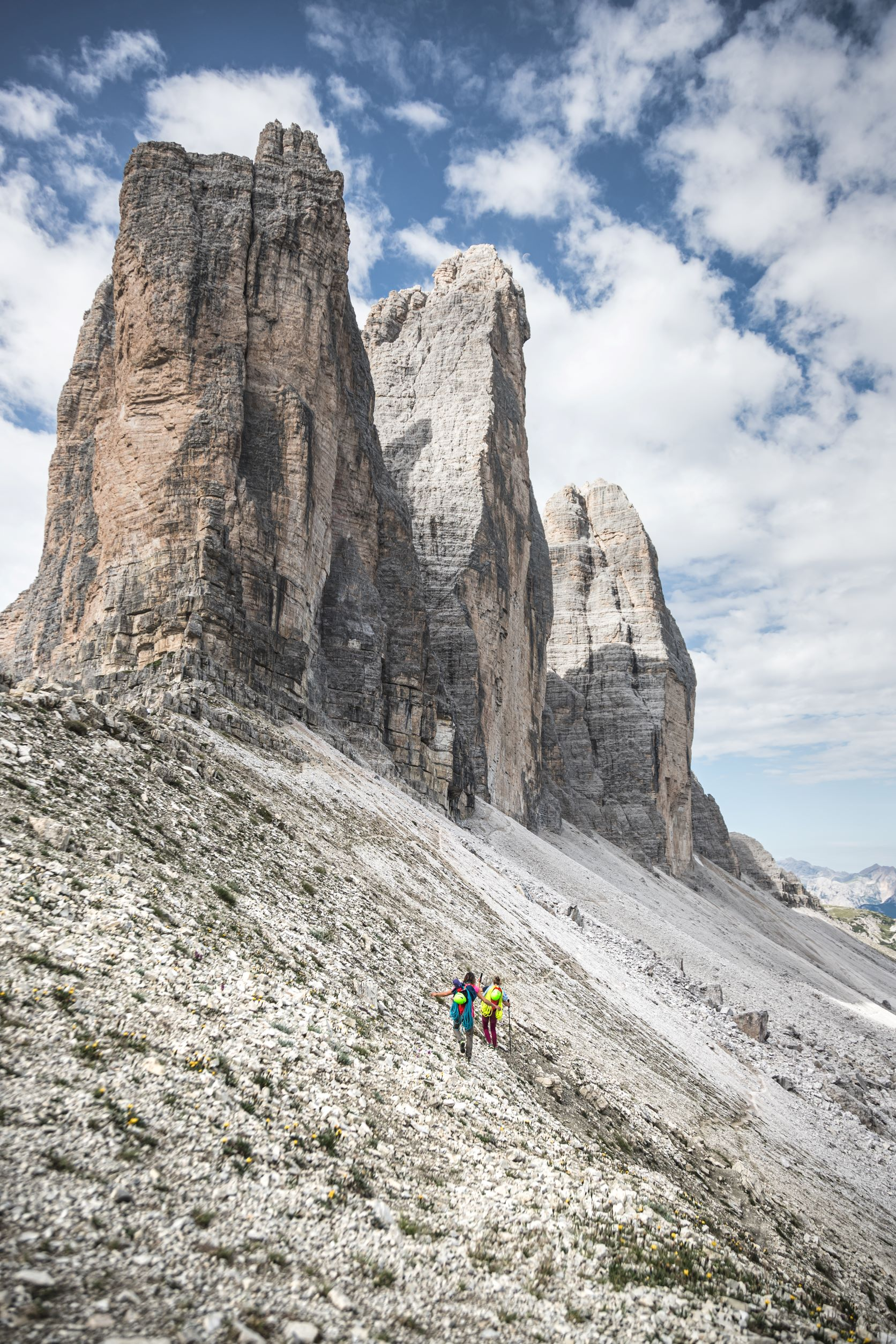 Two climbers hiking up to the Tre Cime di Lavaredo in the Dolomites