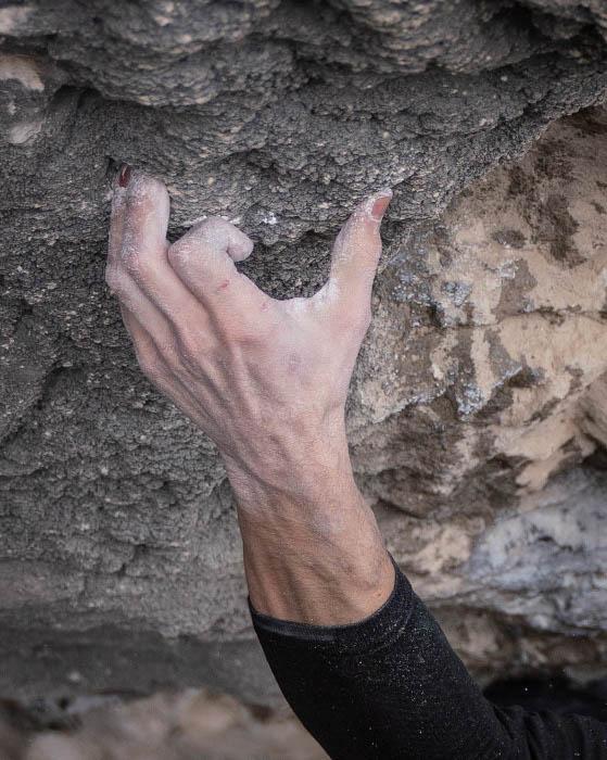 Close up shot of a rock climber's hand