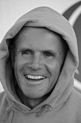 Hugh Murray smiling wearing a hoody