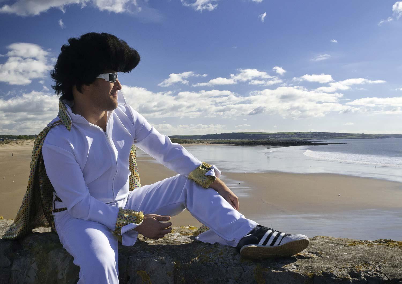 Elvis tribute sitting on sea wall