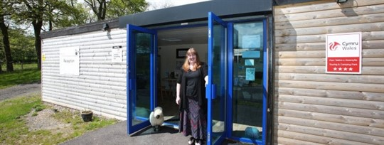 Eira Edwards from Our Welsh standing in an open door