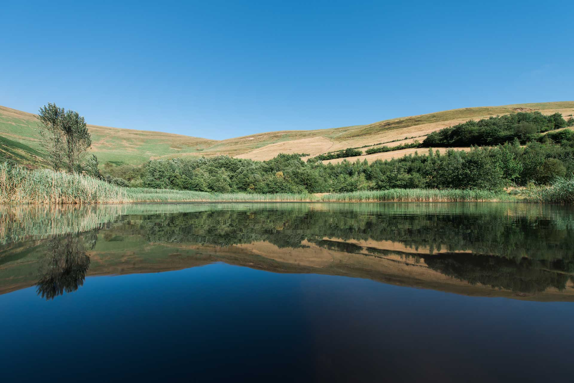 Calm water reflections at Garw Valley