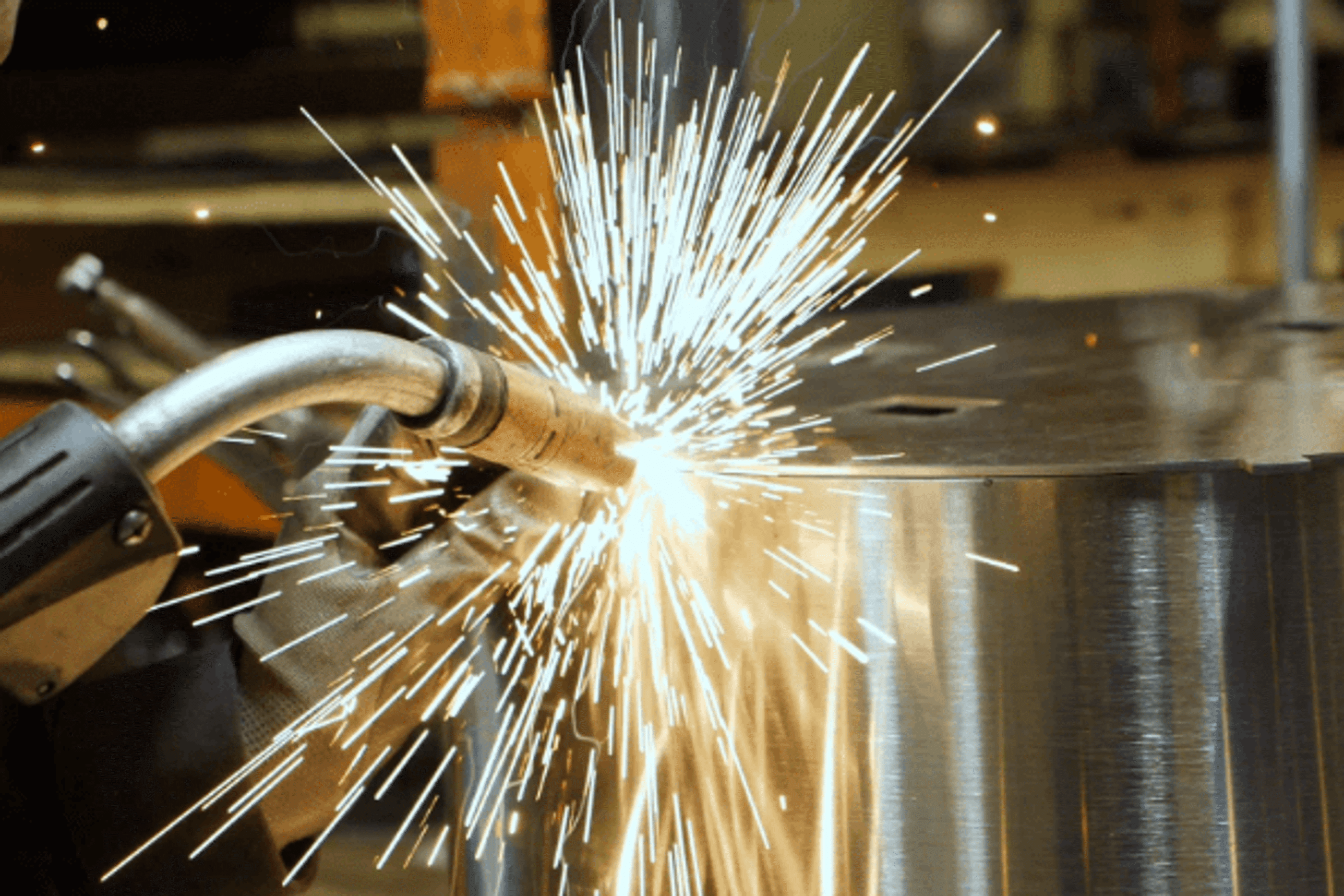 A welder creating a Breeo fire pit.