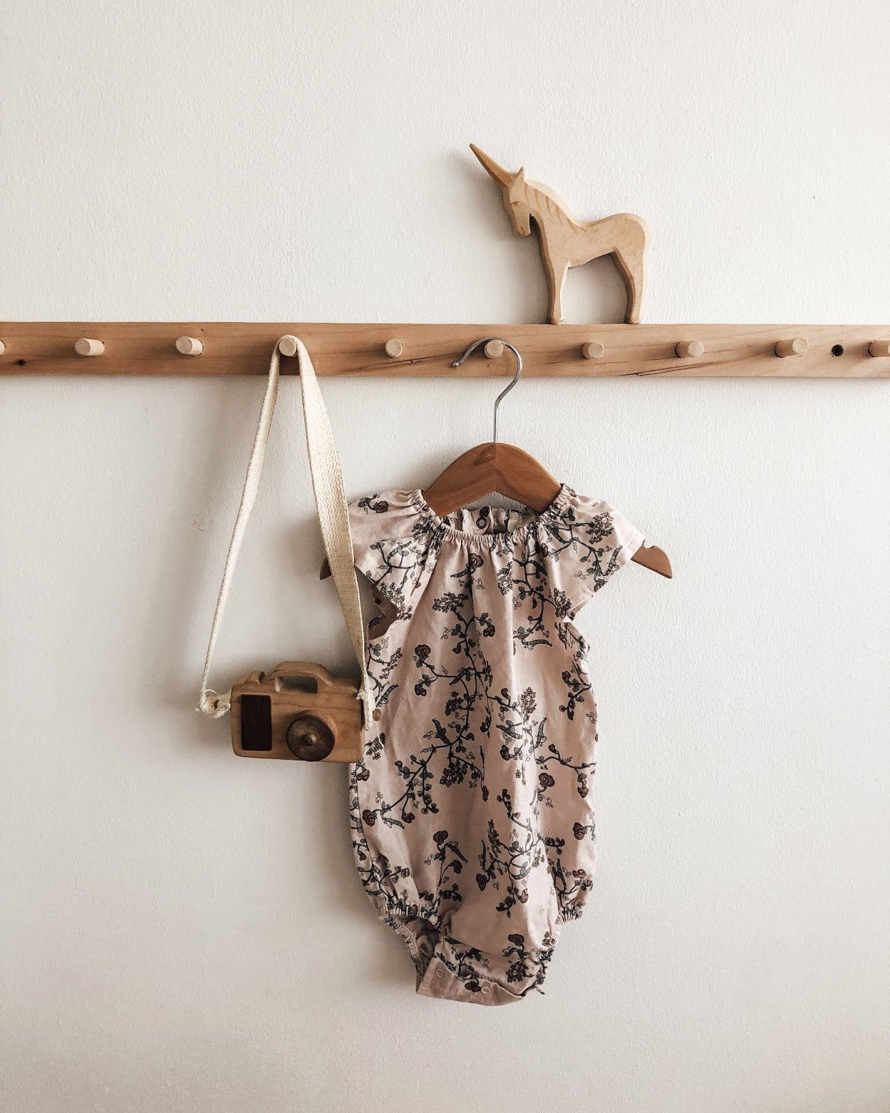 A child's jumper hanging on the wall.