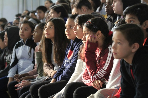 Sixth grade students await the announcement of which Olympic athlete will be their Classroom Champions mentor in the gym at Oak Grove Middle School in Concord, Calif., during a welcome rally on Friday, Sept. 22, 2017. Mt. Diablo Unified School District has partnered with Classroom Champions an international non-profit that pairs teachers with Olympians and Paralympians to be mentors using video lessons, live video chats and social media to encourage them to recognize their potential, set goals and dream big. (Laura A. Oda/Bay Area News Group)