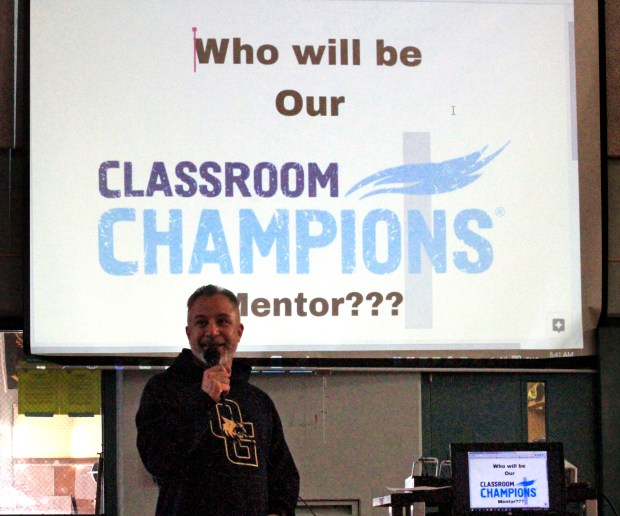 Sixth grade english/history teacher Daniel Buitrago is about to reveal the identity of the Olympic athlete who will be their Classroom Champions mentor in the gym at Oak Grove Middle School in Concord, Calif., during a welcome rally on Friday, Sept. 22, 2017. Mt. Diablo Unified School District has partnered with Classroom Champions an international non-profit that pairs teachers with Olympians and Paralympians to be mentors using video lessons, live video chats and social media to encourage them to recognize their potential, set goals and dream big. (Laura A. Oda/Bay Area News Group)