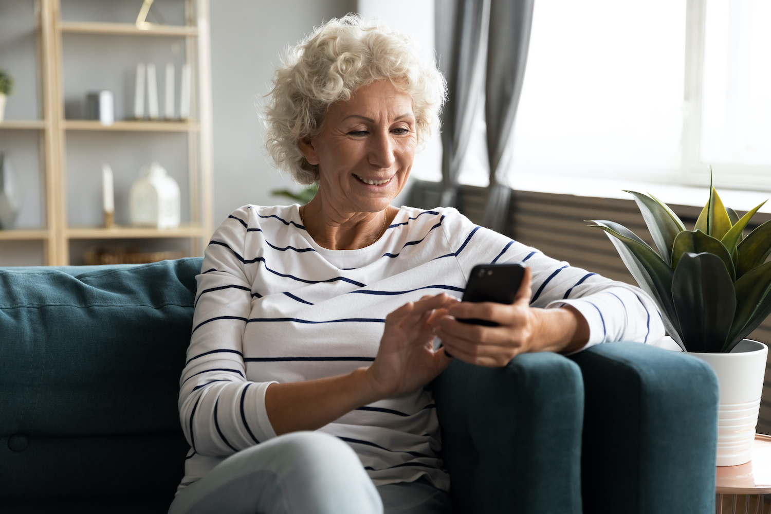 elderly woman using LittleBird app for support