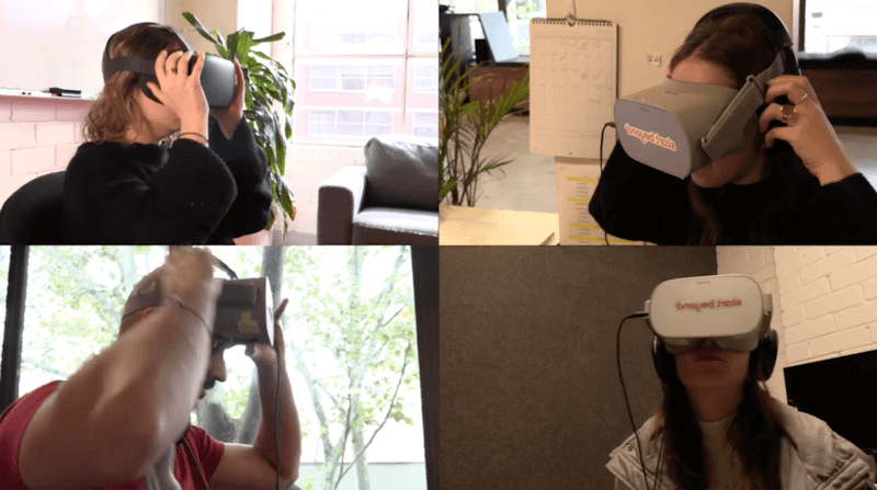 Employees putting on headsets for immersive VR meeting