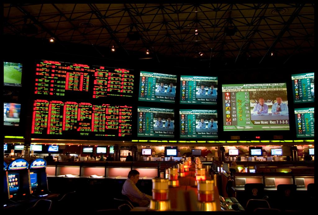 Inside casino, screens of sportsbooks stats and sports betting picks