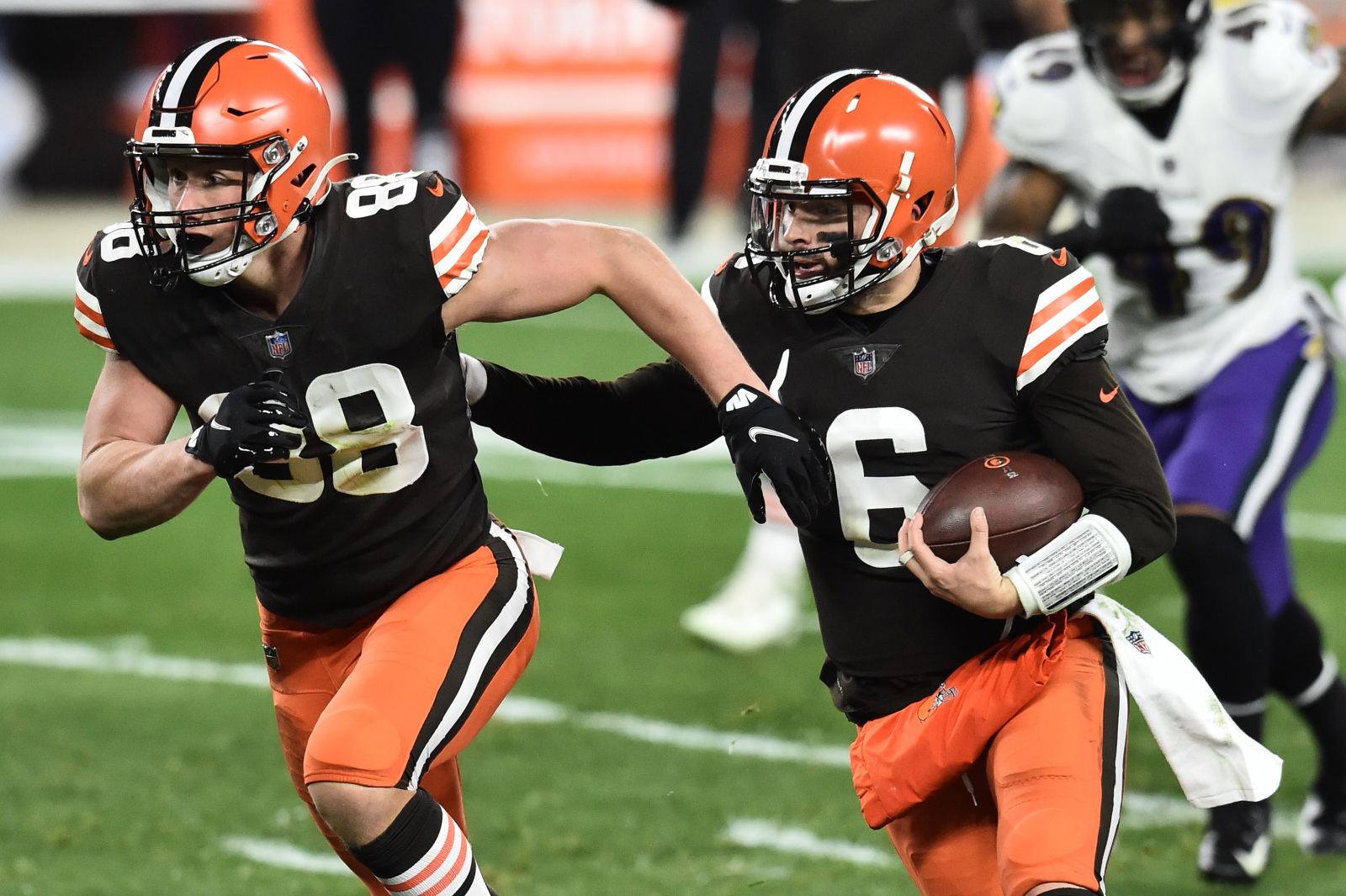 Cleveland Browns quarterback Baker Mayfield #6, running the ball down the NFL field with #38 Ty Zimmerman
