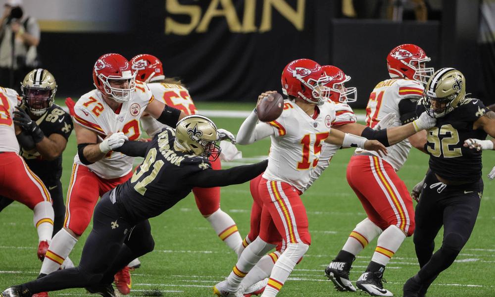 New Orleans Saints vs Kansas City Chiefs quarterback throwing football down NFL field