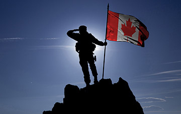 Canadian veteran atop a rock