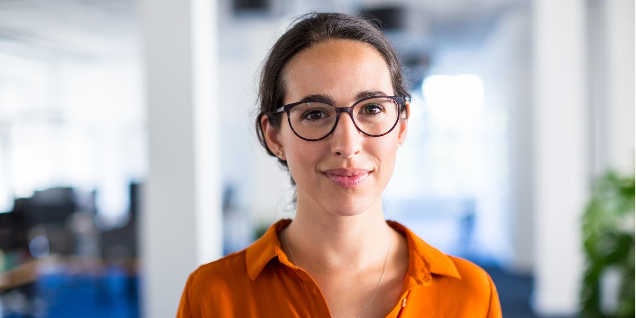 Orange Logic employee with glasses