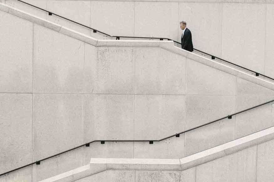 Man climbs up a flight of stairs
